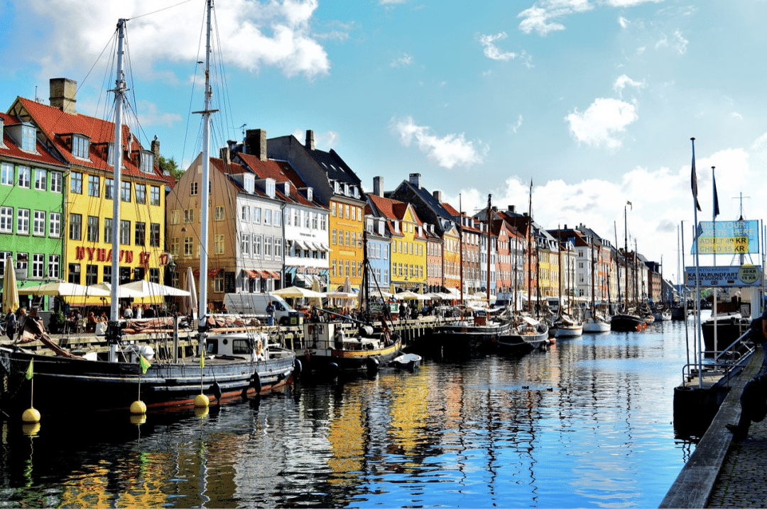 best countries to move to - Denmark Copenhagen Water Nyhavn District Reflection